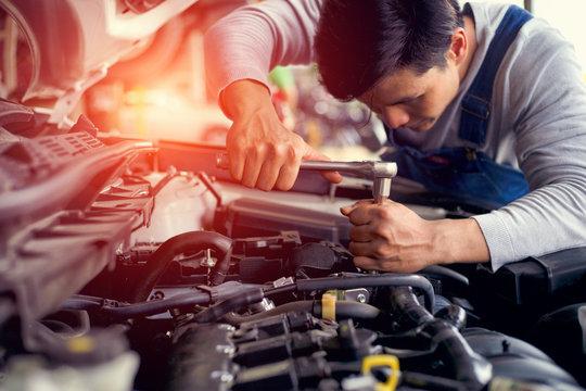 Professional car mechanic check engine car in car garage