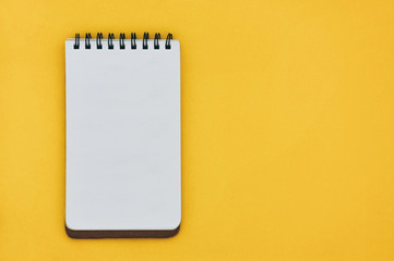 top view of empty open lined notebook on yellow blackground with copy space, flat lay Wall mural