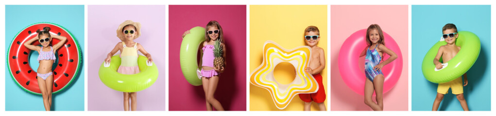 Set of cute little children with bright inflatable rings on color background