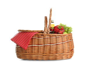 Picnic basket with fruits and lemonade isolated on white