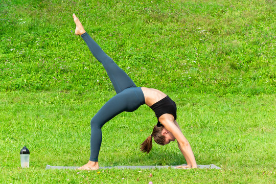 Woman on a yoga, relax in the park.