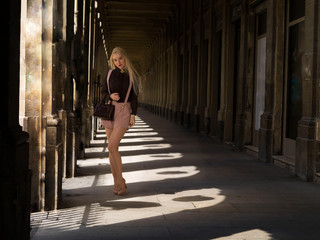 Blonde girl in the shadows