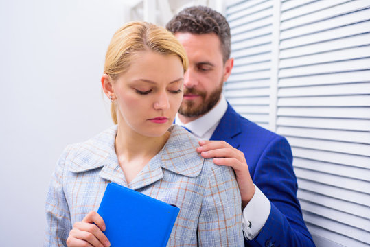 Sexual harassment at work. Sexual harassment between colleagues and flirting in office. Victim of sexual assault and harassment at workplace.