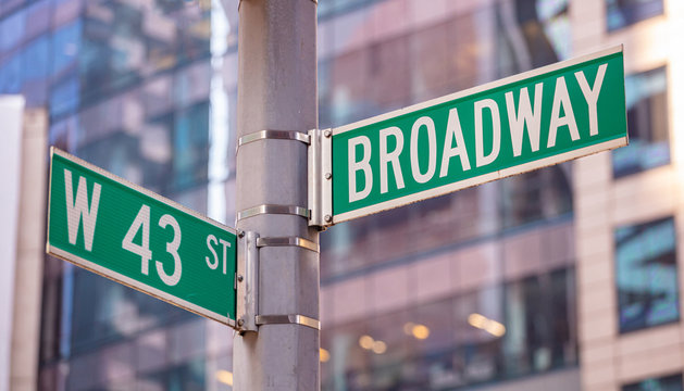 Broadway and W43 corner. Green color street signs, Manhattan New York downtown