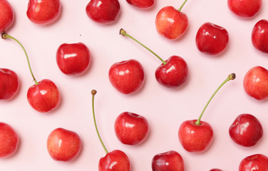 Sweet cherries on pink background, top view Wall mural