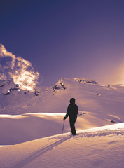 Ski Tour in the austrian alps - man looking at mountains