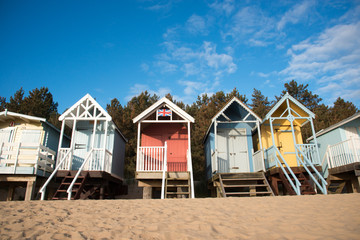 Fototapete - Medium Close Up of Beach Huts in Norfolk