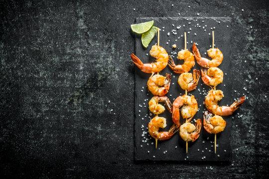 Fragrant shrimps grilled on a stone Board.