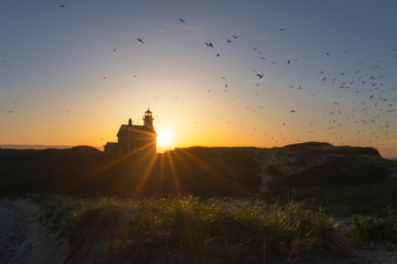 Silhouette of North Lighthouse at sunset on Block Island  Fototapete