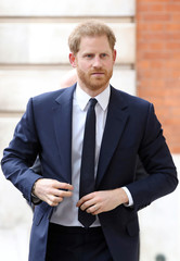 Britain's Prince Harry attends a garden party to celebrate the 70th anniversary of the Commonwealth