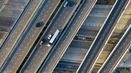 Aerial top view of highway, Transport city junction road with car on Intersection cross road shot...