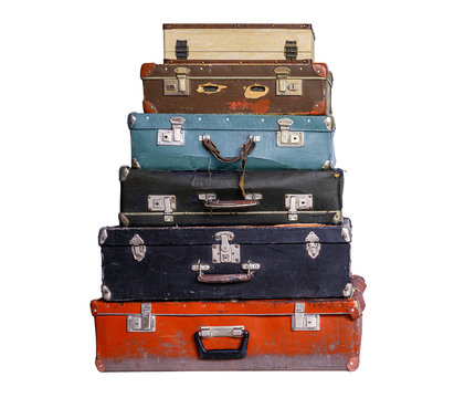 Old suitcases stack isolated.
