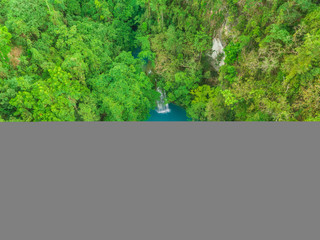 Aerial view of people swimming in pool by Kawasan Falls in Alegria, Philippines.