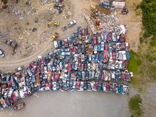 Aerial view above of small junkyard with rusty cars, Wasilla, Alaska.