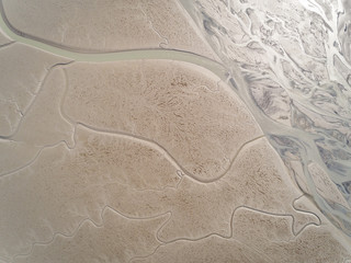 Aerial view above river creating an abstract pattern, Kachemak bay, Alaska.