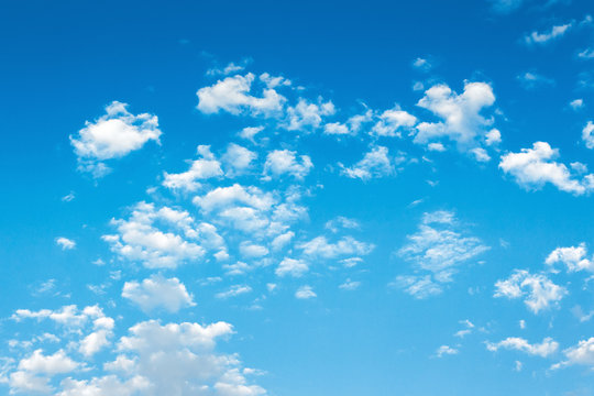beautiful summer sky background. lots of white fluffy clouds on the blue sky. vivid nature background. calm and sunny weather