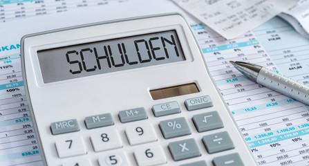 Fotomurales - Taschenrechner mit Dokumenten - Schulden