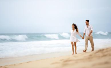 Affectionate couple walking beach