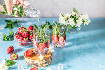 Detox infused water with strawberry and mint in highball glasses
