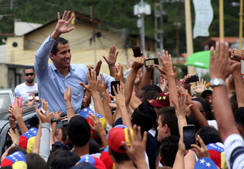 Venezuelan opposition leader Juan Guaido, who many nations have recognised as the country's rightful interim ruler, greets supporters after delivering a speech in Tovar