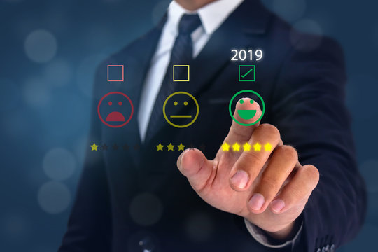 2019 man point hand to the  happy face satisfication with bussiness experiance with graph growth in year 2019