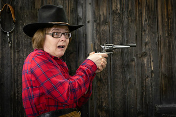 caucasian woman firing gun with  surprised look on her face