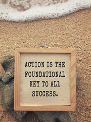 Motivational and inspirational wording - Action Is The Foundational Key To All Succes. Vintage styled background.