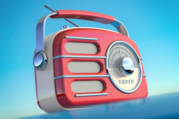 Red vintage retro style radio receiver on the sky background.