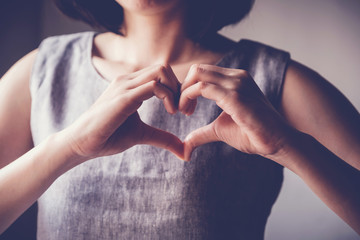 young woman making her hands in heart shape, heart health insurance, social responsibility, donation charity concept, world health day, world mental health day, world heart day, Sign Languages