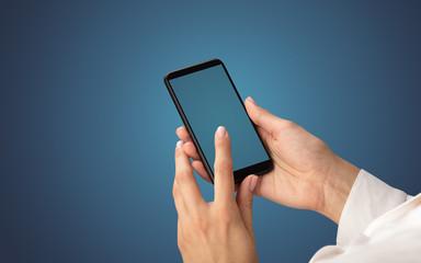 Mockup for female hand using frameless smartphone with dark background