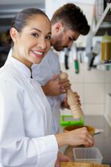 female kitchen staff smiling
