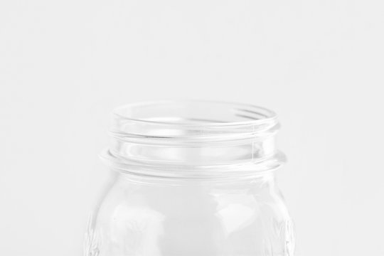 Glassware crystal mason jar on white wall background. Reusable materials plastic-free alternatives zero waste environmental protection food storage concept. Mockup poster with copy space