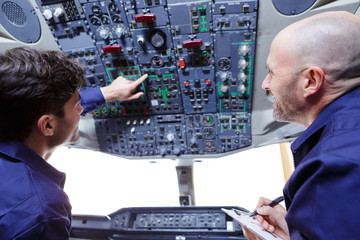 technician inspecting cockpit panel