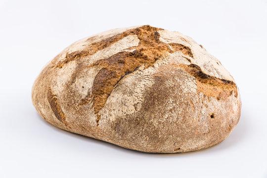 whole rye dark bread isolated on white background