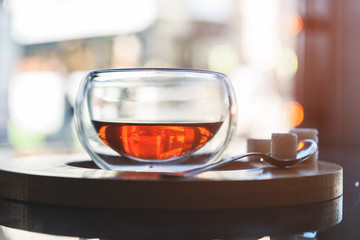 Glass Cup of tea on the table in the cafe