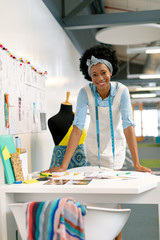 Female graphic designer leaning on table