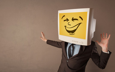 Young person with happy smiley monitor head