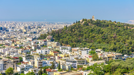 Fototapete - Panorama of Athens with Philopappu or Muse Hill, Greece. It is a tourist attraction of Athens. Scenic view of the Athens city from the famous Acropolis. Urban landscape in summer. Athens skyline.
