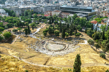 Fototapete - Theatre of Dionysus at the foot of Acropolis, Athens, Greece. It is an old landmark of Athens. Scenic panorama of Athens city taken from above. Cityscape of Athens with the famous Ancient Greek ruins.