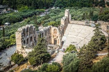 Fototapete - Odeon of Herodes Atticus at Acropolis, Athens, Greece. It is one of the main landmarks of Athens. Landscape with antique amphitheater. Scenic view of famous Ancient Greek ruins in the Athens center.