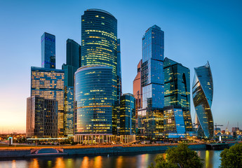 Fototapete - Moscow-City at sunset, Russia. Moscow-City is a business district at Moskva River. Night view of commercial and residential skyscrapers. Panorama of modern tall buildings in the Moscow center at dusk.