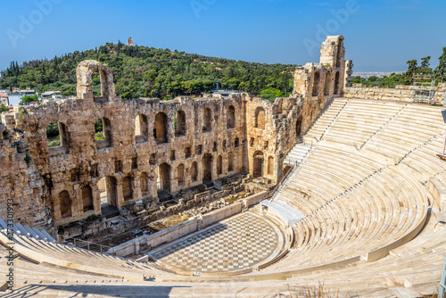 Fototapete Odeon of Herodes Atticus at Acropolis, Athens, Greece. It is one of the top landmarks of Athens. Panorama of antique amphitheater. Scenic view of famous Ancient Greek ruins in the Athens center.