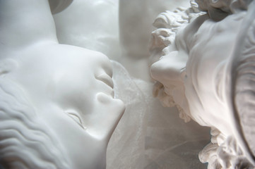 Antique statues of woman and man heads close up. Concept of style, vintage, love.