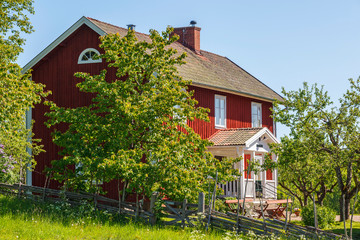 Red old country house with garden