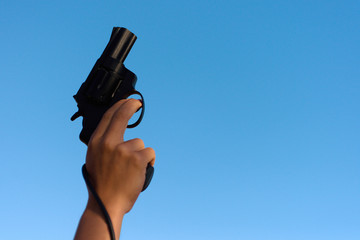 A hand shotting a gun for starting race