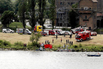 Rescue team work at the scene of the accident during the Air Picnic in Plock