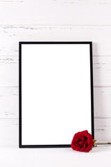 Black frame mockup and red rose flower