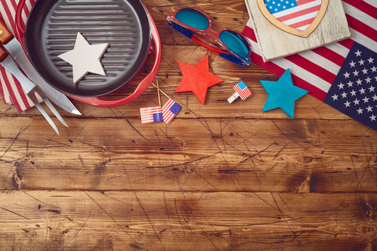 Happy Independence Day, 4th of July celebration concept with USA flag and barbeque grill  on wooden background.