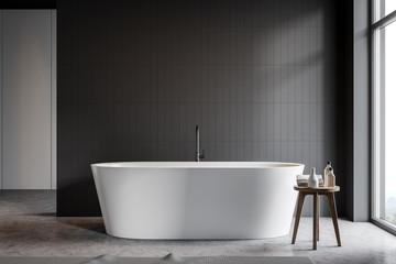 Gray tile bathroom interior with tub