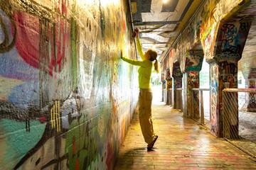 Spray Painting Graffiti in Krog Street Tunnel, Atlanta, Georgia Wall mural